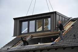 Dormer loft conversion verses velux loft conversion john for How much does it cost to build a dormer window